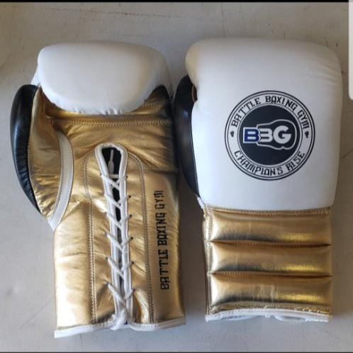 16oz pro boxing gloves.  Custom, hand-stitched 100% leather.  Color variations are available.